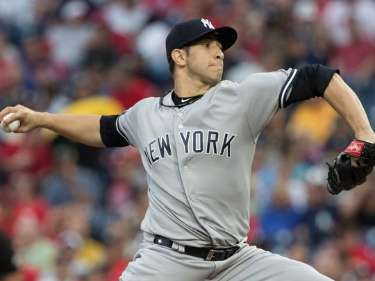 Jun 27, 2018; Philadelphia, PA, USA; New York Yankees relief pitcher Luis Cessa (85) pitches during the first inning against the Philadelphia Phillies at Citizens Bank Park.