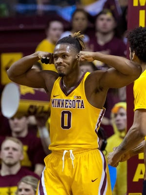 Minnesota Gophers guard Akeem Springs (0) celebrates his basket in the first half against the Michigan Wolverines at Williams Arena.