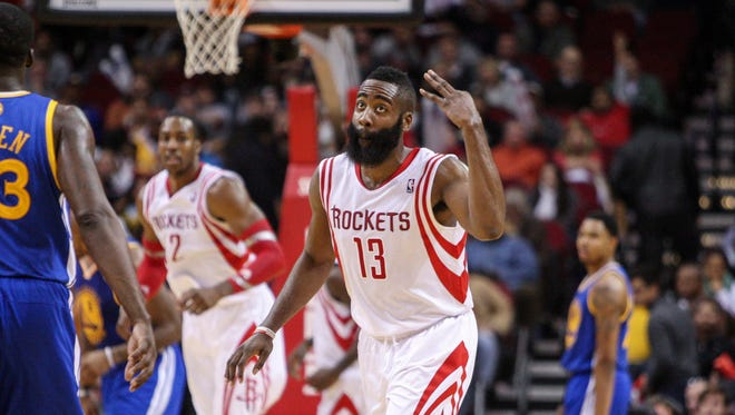 Houston Rockets shooting guard James Harden (13) reacts after making a basket during the fourth quarter against the Golden State Warriors at Toyota Center. The Rockets defeated the Warriors 105-83.