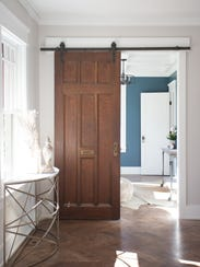 A wooden barn door (from Preservation Station) was