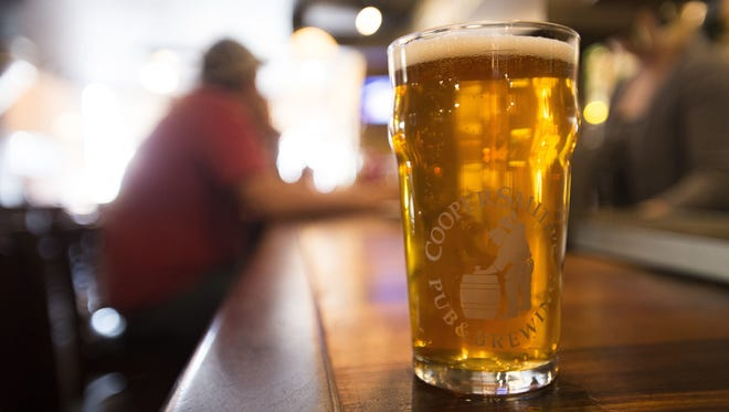 An in-house brewed beer sits on the bar at CooperSmith's Pub and Brewing in Old Town.