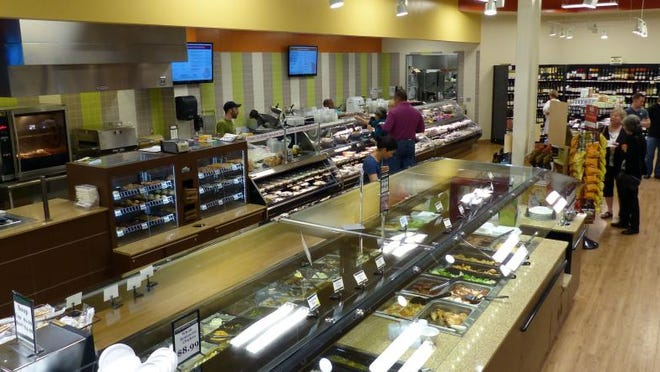Ever'Man Natural Foods will soon be celebrating the grand opening of its major expansion and renovation project.  This photo shows the hot/cold food bar, foreground, and the deli area in the background.