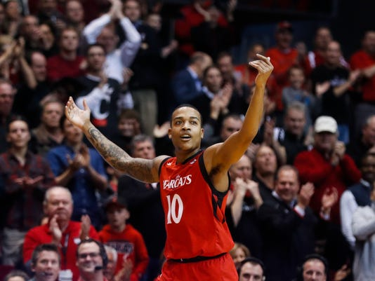 Cincinnati's Troy Caupain acknowledges the crowd, which applauds him during the second half of the team's NCAA college basketball game against Houston, Thursday, March 2, 2017, in Cincinnati. Cincinnati won 65-47. Caupain, a senior, played his final home game. (AP Photo/John Minchillo)