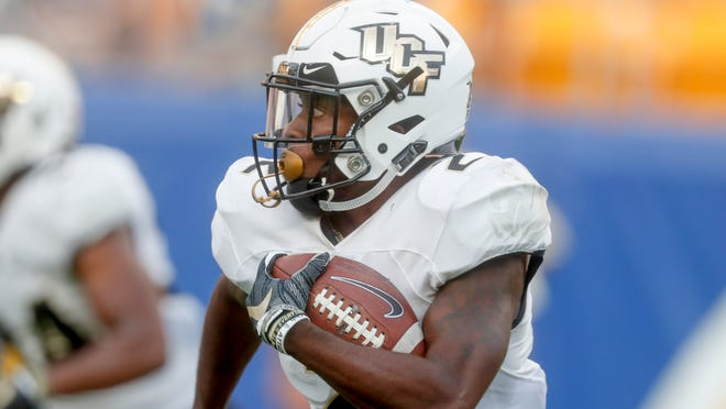 Central Florida's Otis Anderson (2) returns a punt for a long touchdown against Pittsburgh during an NCAA college football game, Saturday, Sept. 21, 2019, in Pittsburgh. (AP Photo/Keith Srakocic) ORG XMIT: PAKS