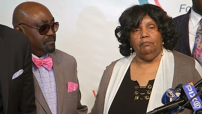 In this photo taken from video, the Rev. Joey Crutcher and Leanna Crutcher stand at the podium at the National Action Network in New York on Sept. 21, 2016. Their son, Terence Crutcher, was shot and killed by a white Tulsa, Okla., police officer on Sept. 16.