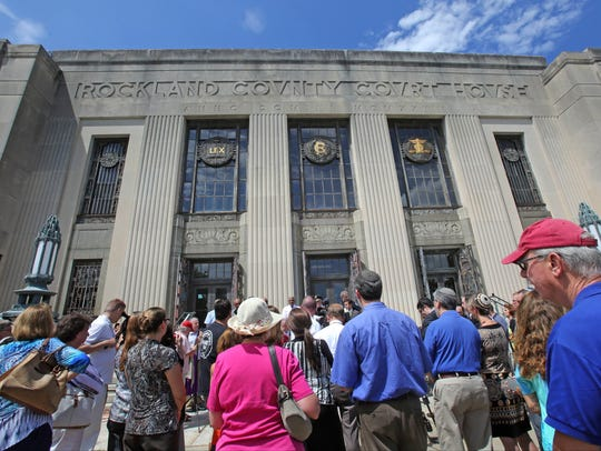 People gather outside of the Old Rockland County Courthouse