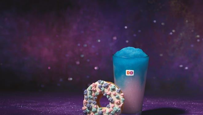 The Dunkin' Donuts Cosmic Cotton Candy Coolatta and Comet Candy Donut launch on Monday.