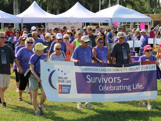 File: The Survivor Lap at Relay for Life, with caregivers included.