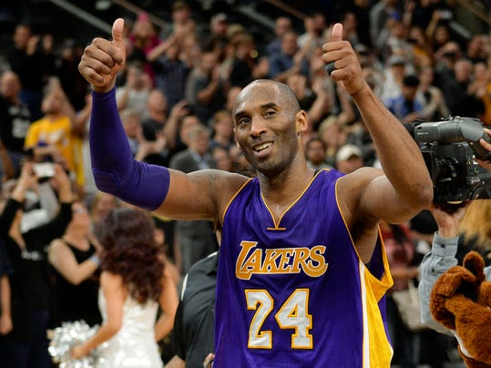 FILE - In this  Saturday, Feb. 6, 2016 file photo, Los Angeles Lakers guard Kobe Bryant gestures to fans as he walks off of the court after an NBA basketball game against the San Antonio Spurs in San Antonio. The final NBA All-Star Game for Bryant and the first to be staged outside the U.S. is in Toronto, the city that staged the first NBA game 70 years ago and is so enthusiastic for basketball now that it could no longer be ignored no matter what the thermometer says. (AP Photo/Darren Abate, File)