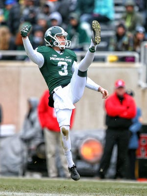 Michigan State Spartans punter Mike Sadler (3) punts the ball during the 2nd half of a game at Spartan Stadium.