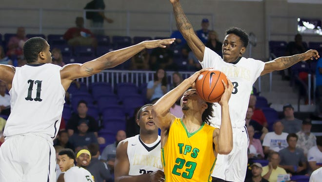 Hudson Catholic's Luther Muhammad, left, and Tyheem Burno block the shot of The Patrick School's Nick Richards during play Sunday (12/18/16) at the Culligan City of Palms Calssic at the Suncoast Credit Union Arena in Fort Myers.