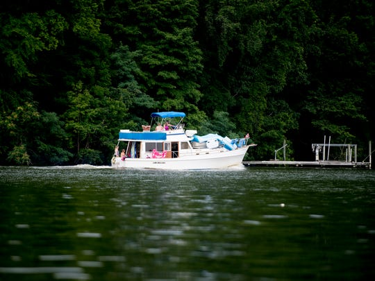 A yacht floats down the lake outside of Fort Loudoun Yacht Club in Knoxville, Tennessee on Saturday, July 7, 2018. TWRA increases its patrols of Tennessee waterways during the summer months to enforce boating regulations and boating safety.