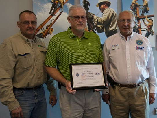 """Pictured left to right: Roger G. """"Grant"""" Hulland, WRVEC"""