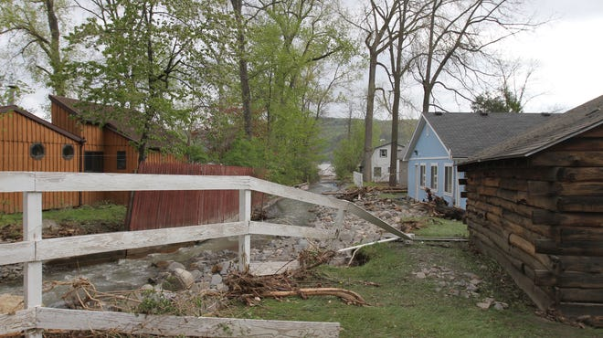 File Photo - The creek next to the cabins at Camp Good Days in Branchport overflowed from the storm in mid-May.