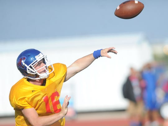 Cooper quarterback Ender Freeman throws a pass during