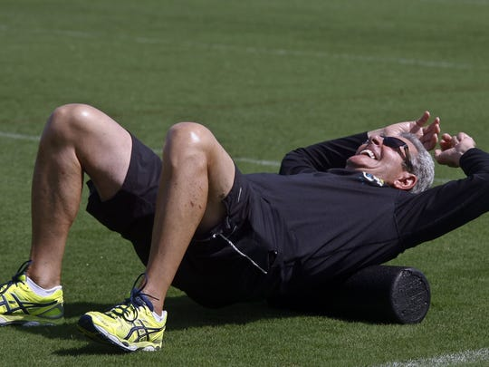 Jerry Sullivan is shown stretching before Jacksonville Jaguars minicamp in 2014. It was announced Wednesday that Sullivan has left his one-year position as LSU's wide receivers coach.