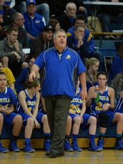 Lincoln coach Rob Bills watches game action of the