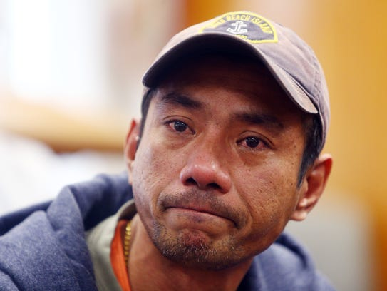 Harry Pangemanan holds back tears as he tells his story