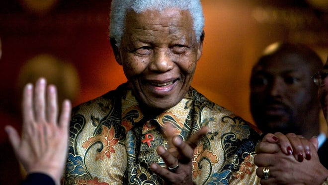 Former South African President Nelson Mandela reacts after a meeting at the Nelson Mandela Foundation building in Johannesburg, South Africa in 2007.