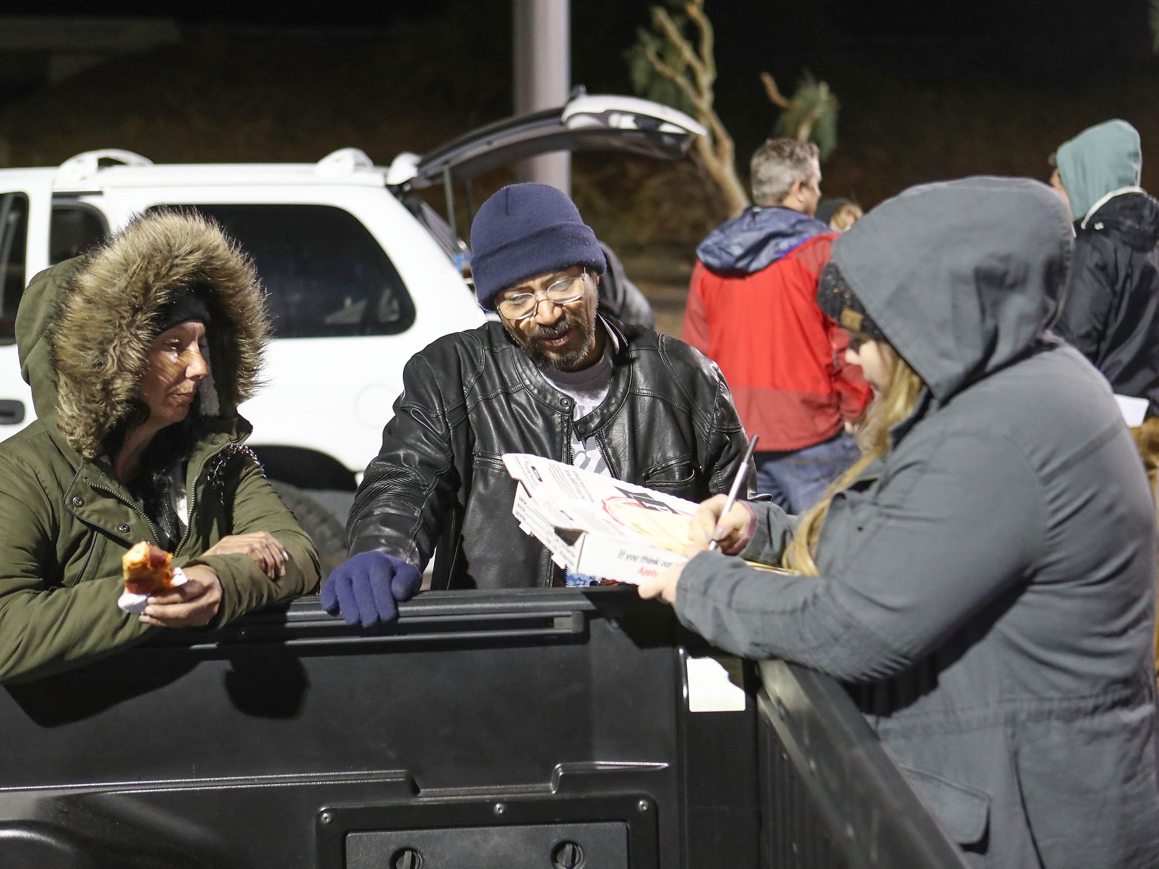 Homeless married couple David Rodriguez, center, and