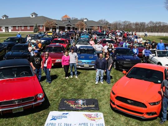 56 Ford Mustangs Cruise Through Morris