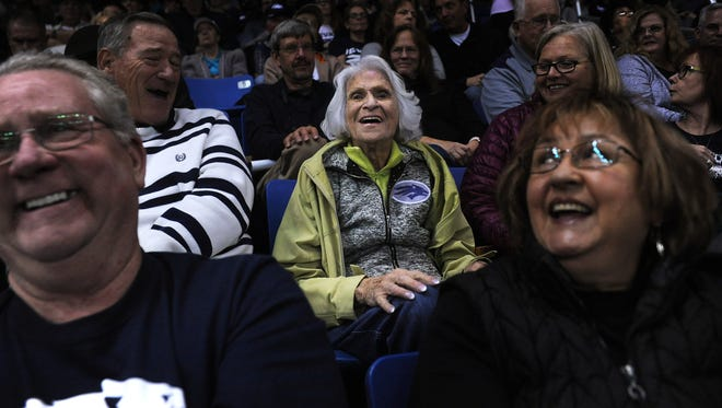 Nina DeVore, middle, enjoys Nevada's game against Utah State at Lawlor Events Center earlier this month.