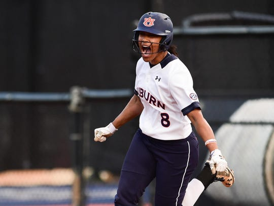 Jade Rhodes (8) runs the bases after a home run against Florida in March.