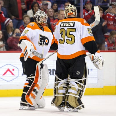 Michal Neuvirth, left, got the first start for the