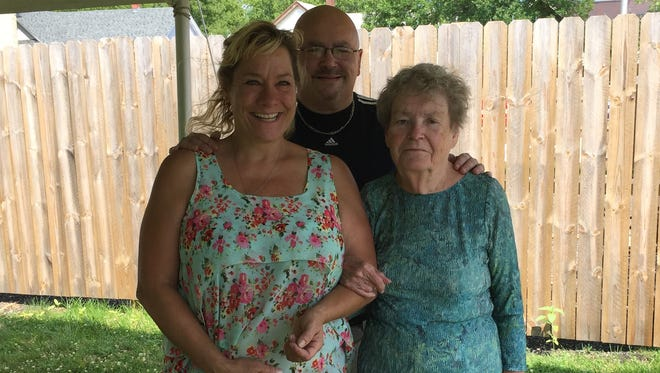 """Mary and Rick Gordon pose with Kay Hofstetter, who they refer to as """"Ma."""" The Gordons will host a benefit for the Hofstetter family Saturday at their bar, M&R Station."""