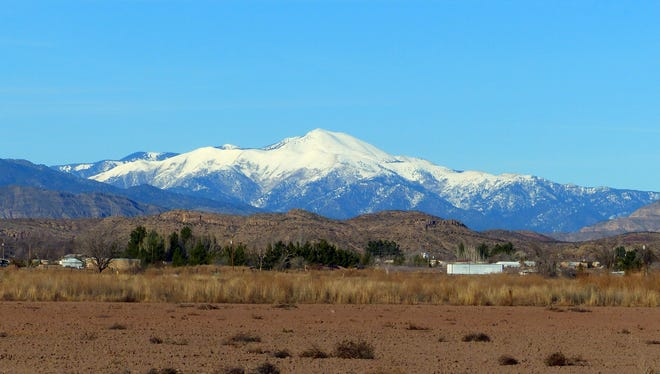 Covered with snow, Sierra Blanca and the surrounding Sacramento beckon to visitors to come to the mountains and play.