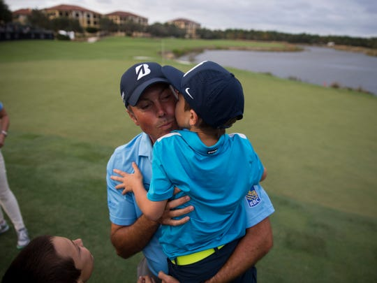 Matt Kuchar receives a kiss from his son Carson Kuchar, 7, after winning the Franklin Templeton Shootout with teammate Harris English at Tibur—n Golf Club at The Ritz-Carlton Golf Resort Saturday, Dec. 10, 2016 in Naples. The duo finished with a score of 28-under par.