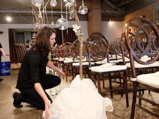 Marissa Rehn, a designer with Flower Gallery, prepares for a wedding at The Venue February 11, 2017. Buncombe marriages are on the rise, despite a falling national trend. More than 2,750 people registered to wed in 2016, giving Buncombe one of the highest marriage rates in the state.
