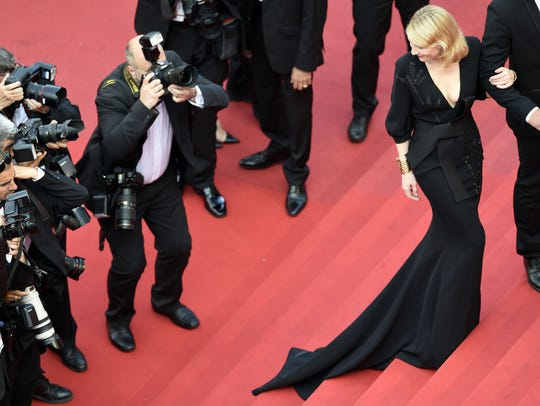 Cate Blanchett poses as she arrives for the premiere