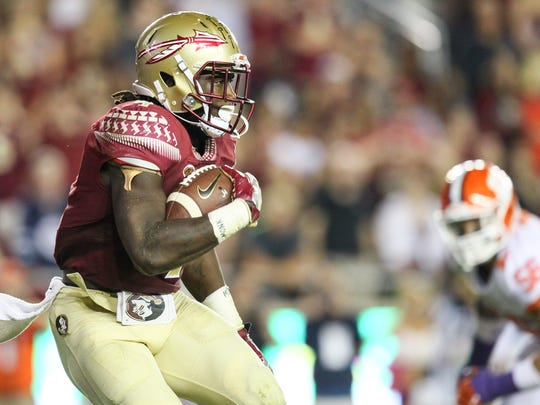 Florida State running back Dalvin Cook (4) turns a corner for a gain against Clemson during the third quarter on Saturday at Doak Campbell Stadium in Tallahassee, Florida.