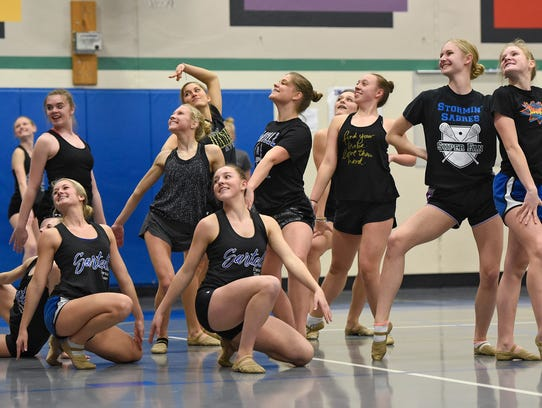 Sartell Dance Team members strike a pose at the end