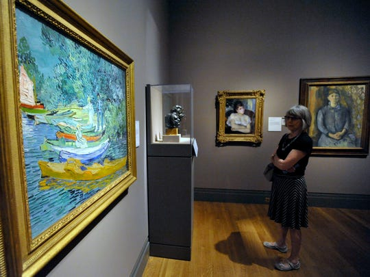 Jane Underwood, of Toronto, looks at the Bank of the Oise at Auvers, 1890, by Vincent van Gogh at the DIA on August 8, 2014.