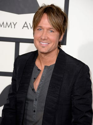 Keith Urban arrives at the Grammys.