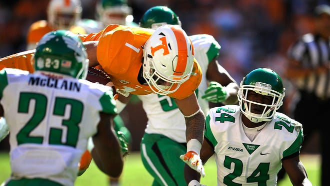 Tennessee running back Jalen Hurd (1) flies through the air as he dives for more yardage against North Texas on Nov. 14, 2015.