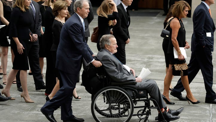 Former president George W. Bush pushes his father,