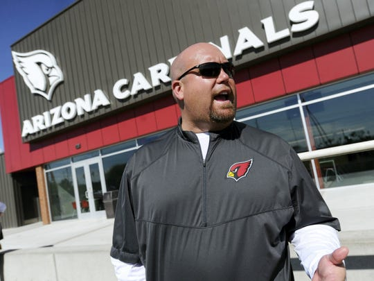 Steve Keim, the general manager for the Arizona Cardinals, looks on during a morning session of organized team activities, or OTAs, at the Cardinals training facility in Tempe on June 4. Keim, a native of York County, was named NFL Executive of the Year for the 2014 season.