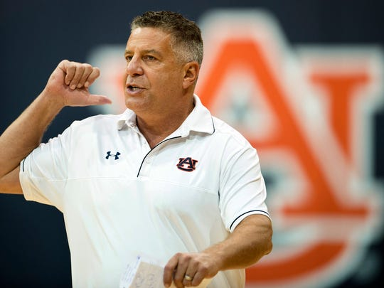 Auburn head coach Bruce Pearl directs his players during NCAA college basketball practice, Friday, Sept. 29, 2017, in Auburn, Ala. Auburn practiced for the first time this season since top assistant Chuck Person's arrest as part of a federal fraud and bribery sting. (Albert Cesare/The Montgomery Advertiser via AP)