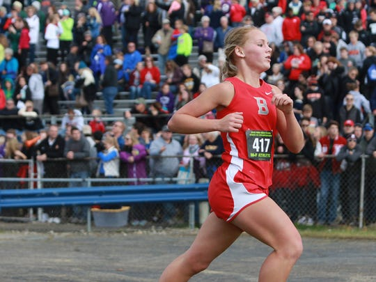 Lauren Turner sprints to the finish line in the Division III state cross country meet.