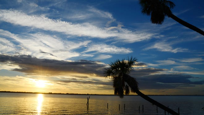 The sun sets along the Indian River lagoon on south Merritt Island.
