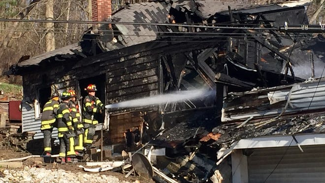 Firefighters are searching for a woman who is unaccounted for after an early morning house fire in Aurora, Indiana.