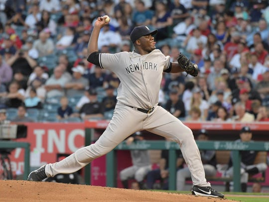Yankees pitcher Michael Pineda (35) delivers a pitch