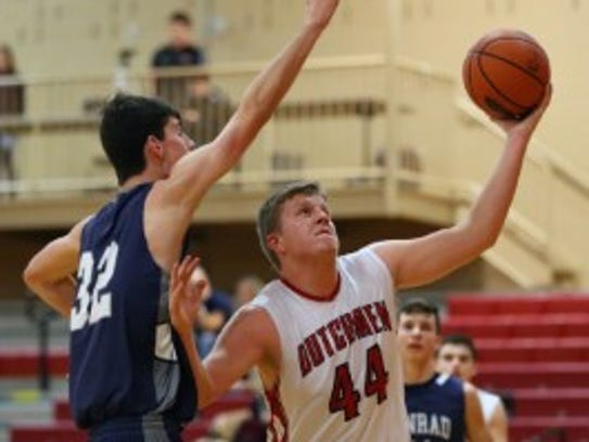 Annville-Cleona's Noah Myers goes up for a lay-up attempt