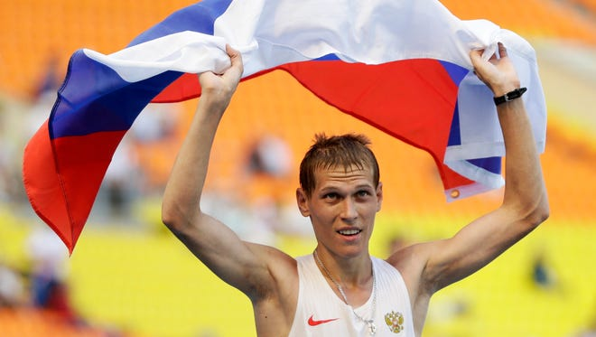 In this file photo taken on  Aug.  14, 2013, Russia's Mikhail Ryzhov celebrates winning silver in the men's 50 kilometer race walk at the World Athletics Championships in Moscow,. Eight Russian doping cases will be decided by the Court of Arbitration for Sport while Russia remains banned  from competition.