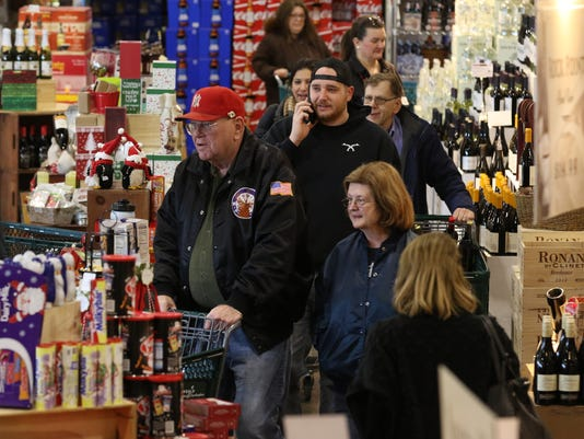 Last minute shoppers at Gary's Wines on Rt 23.