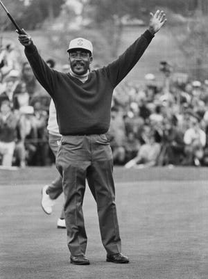 In this Jan. 13, 1969 file photo, Charlie Sifford throws up his arms after he dropped a short par putt on the 18th green to tie Harold Henning of South Africa at the end of 72 holes in the $100,000 Los Angeles Open golf tournament.