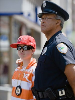 Retired Forest Park police Lt. George Brooks at a police memorial with his son in 2009.